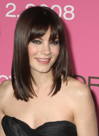Bangs can change the look of any medium-length haircut.